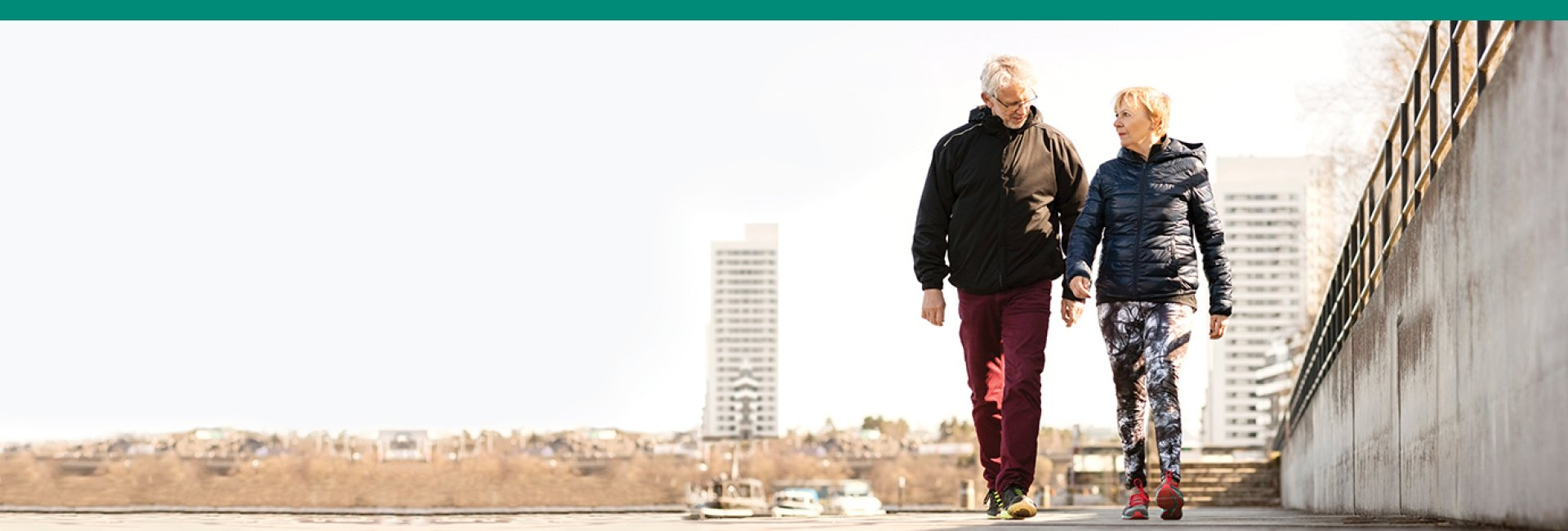 Medical Weight Management/Diet Lecture: Two people walking & holding hands with green/teal border